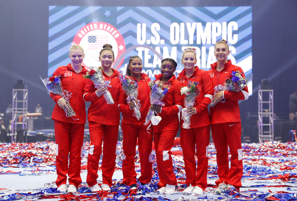 ST LOUIS, MISSOURI - JUNE 27: (L-R) Jade Carey, Sunisa Lee, Jordan Chiles, Simone Biles, Mykayla Skinner and Grace McCallum, the women that will represent Team USA, pose following the Women's competition of the 2021 U.S. Gymnastics Olympic Trials at America's Center on June 27, 2021 in St Louis, Missouri. (Photo by Jamie Squire/Getty Images)